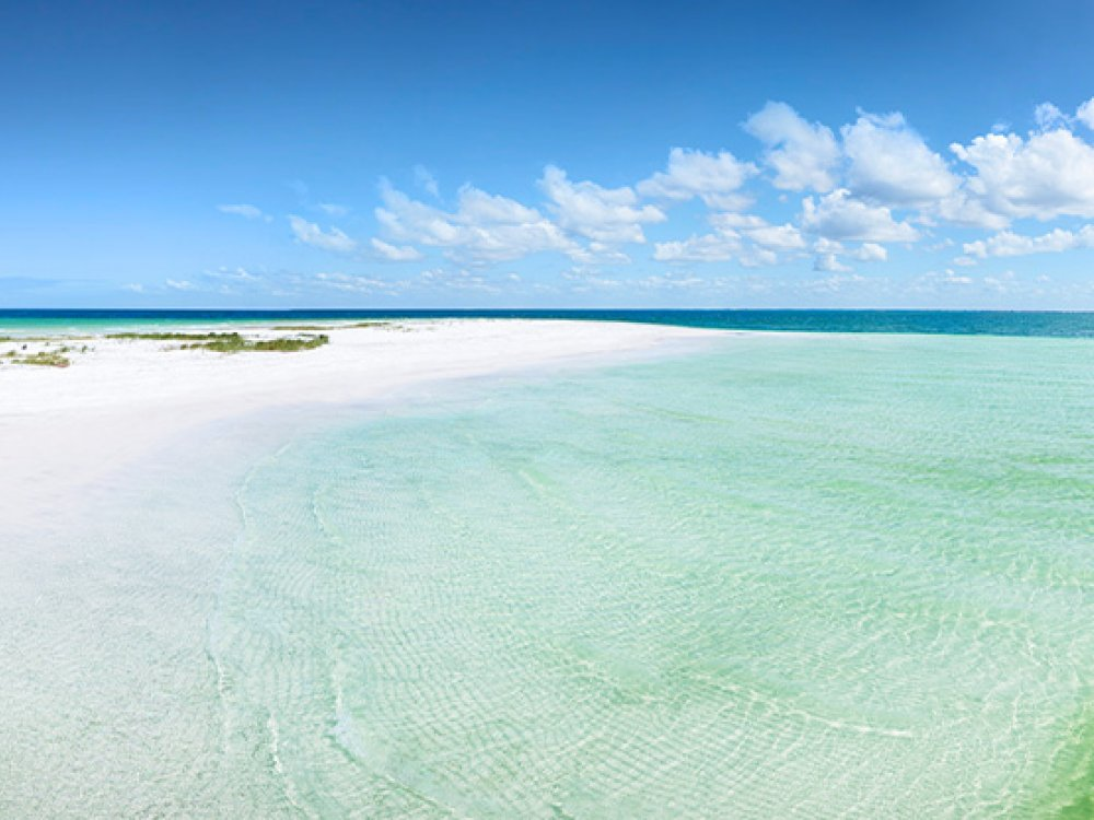 Anclote Key white sand and emerald-green water beach.